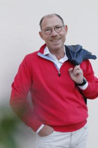 Peter Deth with Jacket above shoulder